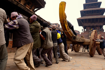 Building Bhairab chariot in preparation of Bisket Jatra: the base of the chariot is assembled near Nyatapola temple (the five storey temple in the background) , then is moved near a platform in front of Bhairabnath temple