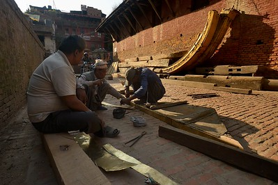 Artisans working on a piece of the chariot roof
