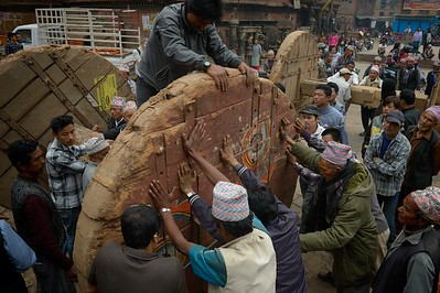 Building Bhairab chariot in preparation of Bisket Jatra: the big wheels are mounted on their axis