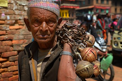 First day of Bisket Jatra: a man carrying bells for Bhairab's chariot