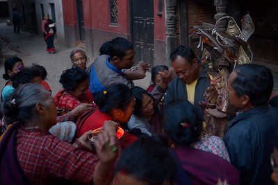 Uppon his arrival to his temporary temple, Bhairab is worshiped by a small crowd of devotees