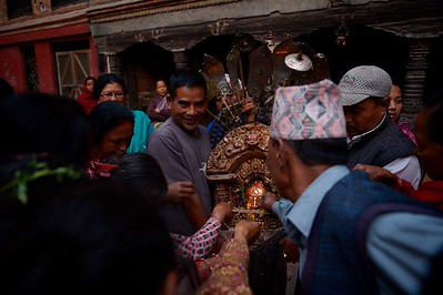 Early in the morning of the second day of Bisket Jatra, Bhairab's effige is unloaded from the chariot and taken to a small temporary temple. Worshipers got a lucky opportunity to touch the god's image