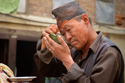 Sindur Jatra: a man preparing for the festival
