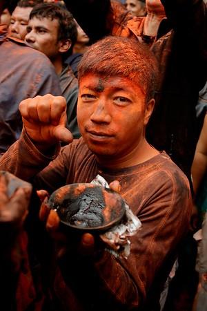 Sindur Jatra: orange powder is well-wishing, while a black tikkha symbolize devotion