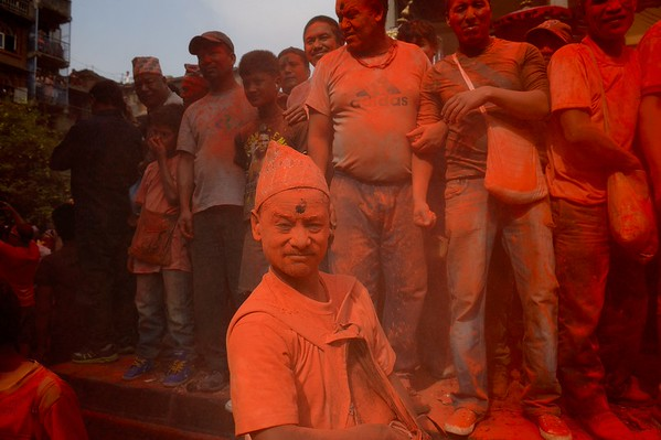 Sindur Jatra: men in a cloud of orange powder