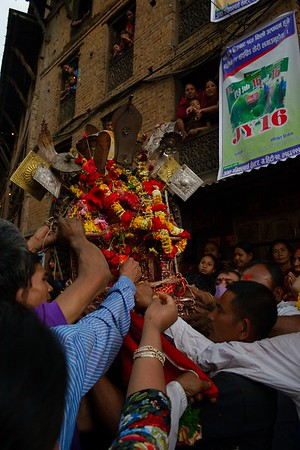 Bhairab's effige being worshipped by a crowd of devotees