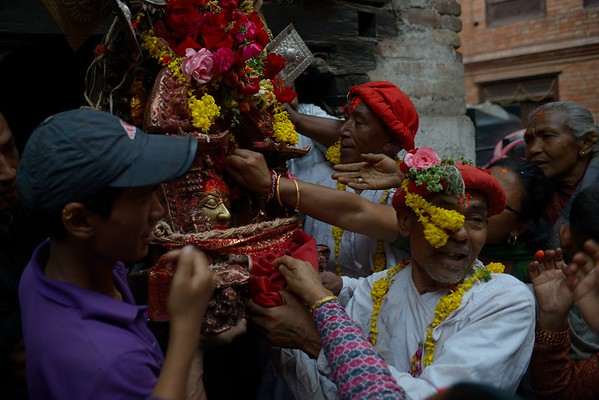 Deo Thaha Biyakegu: carried by white-dressed priests, Bhairab exits his temporary shrine for his last trip to the chariot