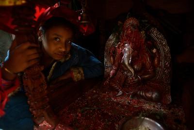 a young girl near Ganesh statue