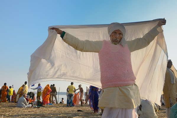 a pilgrim drying his dothi