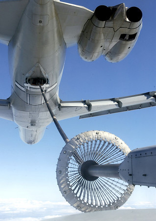 An RAF C130 Hercules transporter refuels from a VC10 in the skies over the Falkland Islands. Image taken by Heidi Burton, MOD Crown Copyright