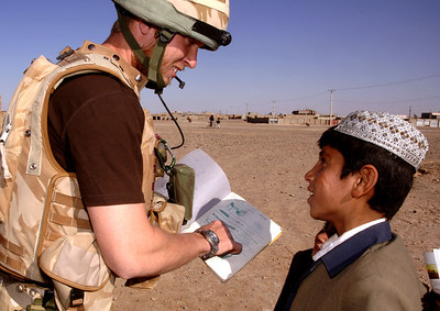 An Engineer helps a local boy with his english homework in Lashkar Gah, Helmand Province, Afghanistan. Image taken by Heidi Burton, MOD Crown Copyright