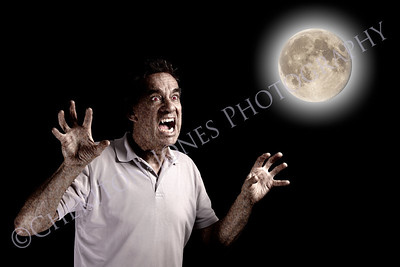Scary Man Werewolf Beast with Fangs under Full Moon