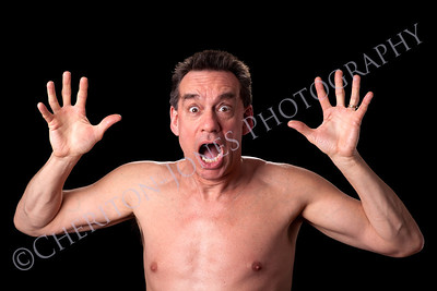 Man Screaming in Horror on Black Background