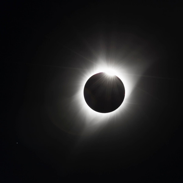The moon  is now moving off the sun.  This is the 3rd contact diamond  ring, still showing a  nice corona.
