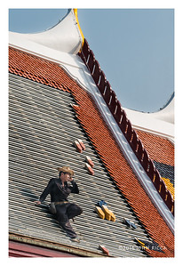 Temple Roofer On Cell Phone, Bangkok