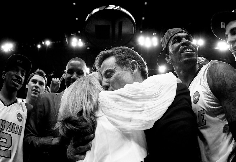 Louisville coach Rick Pitino embraces his wife Joanne after the Cardinals victory over the Florida Gators to advance to the NCAA Final Four.