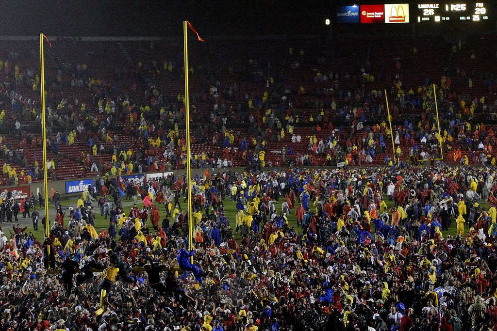 Fans storm the field after Louisville upsets Florida State in overtime