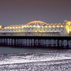 Brighton's palace Pier Illuminated on a snowy winter's evening