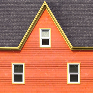Orange wall, grey roof and yellow window frames