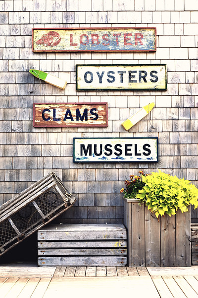 Old fishing signs and lobster trap
