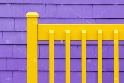 Purple wall and yellow fence