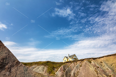 Yellow house on clifftop