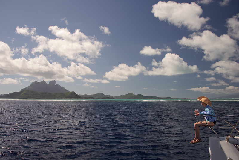 Approaching Bora Bora with Faithie at her favorite vantage point...