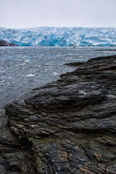 WAb724 Beach Rocks & Glacier, Almirantazgo Bay, Darwin Range, Patagonia, Chile