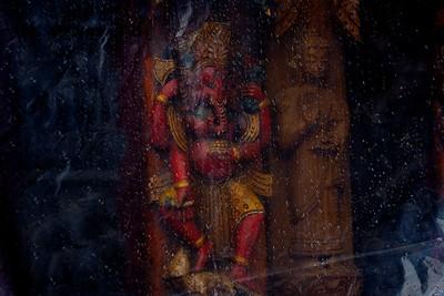 Ganesh and Buddha under raindrops