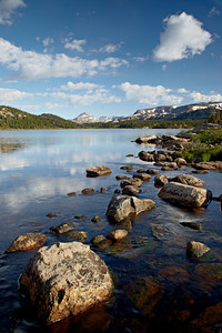 """Outflow""  Rocks and reflections at the outflow of Island Lake. Taken along the Beartooth Pass, Shoshone National Forest, Wyoming, USA."