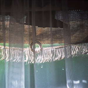 "TK 1980's 004.jpg 0 x 10.8 x10.8cm/4x4"" in stock 0 x 15x15cm/6x6"" in stock  Detail of fraying blind and net curtain in sunshine taken at home in Mt Eden Auckland  around 1983/84."