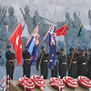 The New Zealand, Turkish  and Australian flags held during the Anzac Day Commemorative Ceremony, Gallipoli Peninsula, Turkey, 2011. Credit: Ministry of Foreign Affairs and Trade