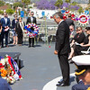 New Zealand Consul General Leon Grice lays a wreath at the 2016 Los Angeles ANZAC Day service on board the USS Iowa