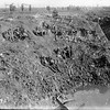 New Zealand Engineers resting in a large shell hole at Spree Farm, Ypres Salient, 12 October 1917. Photograph taken by Henry Armytage Sanders.
