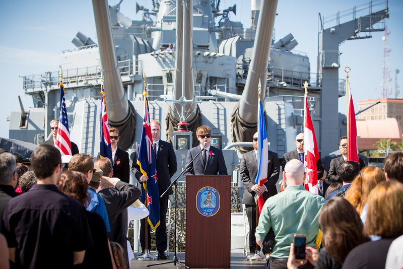 Will Martin sings the national anthems at the 2016 Los Angeles ANZAC Day service on board the USS Iowa