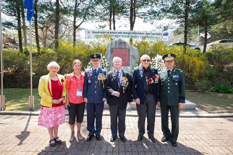 New Zealand Korean War veterans Mr Hugh Blaikie and Mr Bob Keenan with famiies and New Zealand Defence Attache, Group Captain Rod Fortune at the New Zealand Memorial in Kapyong, South Korea on 24 April.