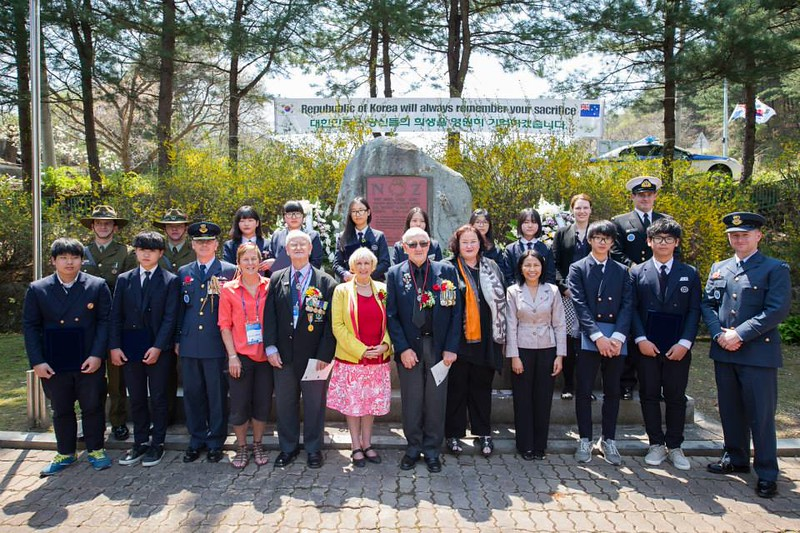 Ambassador Clare Fearnley joins the New Zealand Korean War veterans with families, the NZDF personnel serving in Korea and the Kapyeong-buk Middle School students who receive the scholarships, at the New Zealand Memorial in South Korea on 24 April.