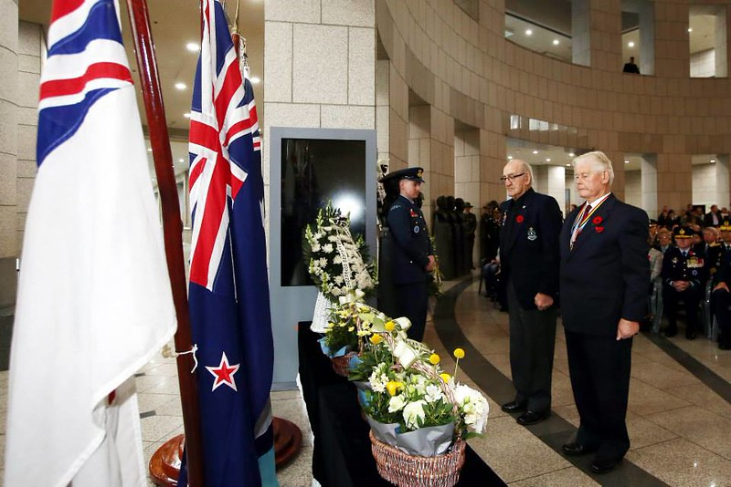 New Zealand Korean War veteran Mr Bob Keenan (left) pays his respect at the Anzac dawn service in Seoul.