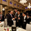 Prime Minister's visit to China 2013. Prime Minister John Key sampling New Zealand wine with Chinese business men at the Investment and Business Executive dinner at the Peace Hotel in Shanghai. Credit NZ Inc, Charlie Xia