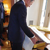 New Zealand Prime Minister Rt Hon John Key opening his official gift from the United States on his official 2011 U.S visit.  The gift of a replica Hobbit sword, was made by Weta Workshop in Wellington and the gift was organised by Hobbit backers Warner Brother. Credit: Mike Waller