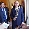 New Zealand Prime Minister Rt Hon John Key opening the official gift to New Zealand from the United States to mark his 2011 U.S visit.  The gift of a replica Hobbit sword, was made by Weta Workshop in Wellington and the gift was organised by Hobbit backers Warner Brothers. Credit: Mike Waller