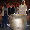Former New Zealand Minister of Foreign Affairs, Winston Peters with Makuni Village Mayor demonstrating the use of World Food Programme fuel efficient stoves, Livingstone, Zambia 2008. Funded by the New Zealand Aid Programme. Credit: New Zealand Ministry of Foreign Affairs and Trade