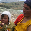 Mother and baby taking a break in the potato fields, Huancayo, Peru. Credit: New Zealand Ministry of Foreign Affairs and Trade