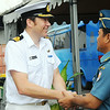 Commander Jonathan Beadsmoore of the HMNZS Te Kaha is welcomed by Col. Deddy Pribadi the Deputy Commander of the Jakarta Naval Port during a HMNZS Te Kaha visit to Jakarta, November 2011.