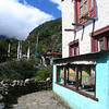 Village on the road to Namche, Nepal - prayer wheels in the windows. Credit: New Zealand Ministry of Foreign Affairs and Trade