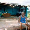Man outside the remains of his home in Uluinakavika, Fiji after Cyclone Ami, 2003. Credit: New Zealand Ministry of Foreign Affairs and Trade