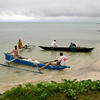 Fishermen heading out for a day's work in their outrigger canoes, Samoa. Credit: New Zealand Ministry of Foreign Affairs and Trade