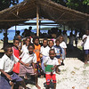 School children under a shelter in Solomon Islands during Marian Hobbs visit, 2004. Credit: New Zealand Ministry of Foreign Affairs and Trade