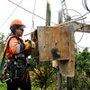 Lineswoman working on the power lines in Tonga. Credit Pedram Pirnia