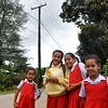 School children under power lines in Tonga. Credit Pedram Pirnia